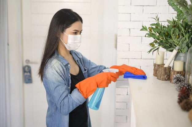 woman using gloves and sanitizer